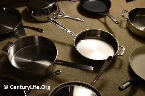 Most of these pans have stainless steel cooking surfaces, with aluminum or copper disc bases bonded to the bottom or laminated onto the stainless steel--a multi-layered material.