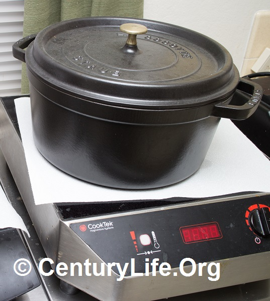 One of my enameled cast iron French ovens, a 6.25 quart round Staub. I bought it in black because I liked its faux bare cast iron look. My most-cooked recipe in this: cioppino (seafood tomato stew, which is highly acidic). I used to have various other ovens including a blue Le Creuset 7 1/4 quart round, but I downsized.