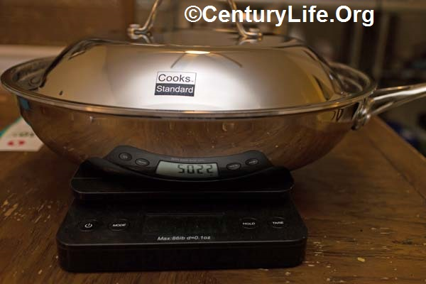 Cooks Standard 12 inch skillet with lid. Non-optional tacky laser-etched logos on every lid can't be scrubbed off and could bother some potential buyers.