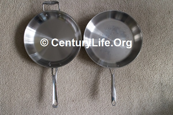 Culina on the left, Cooks Standard on the right. The Cooks Standard handle is just a little bit too short to comfortably tuck underneath one's arm. The Culina does ok and has a helper handle in any case.